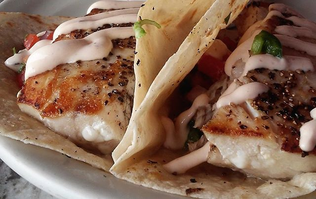 Our weekend special is Fish Tacos! You get 8 oz. of Grilled Mahi Mahi with Pico de Galo, Cajun Slaw, Chipotle Lime Sour Cream, and a side of Basmati Pilaf. Y'all, this is tasty.