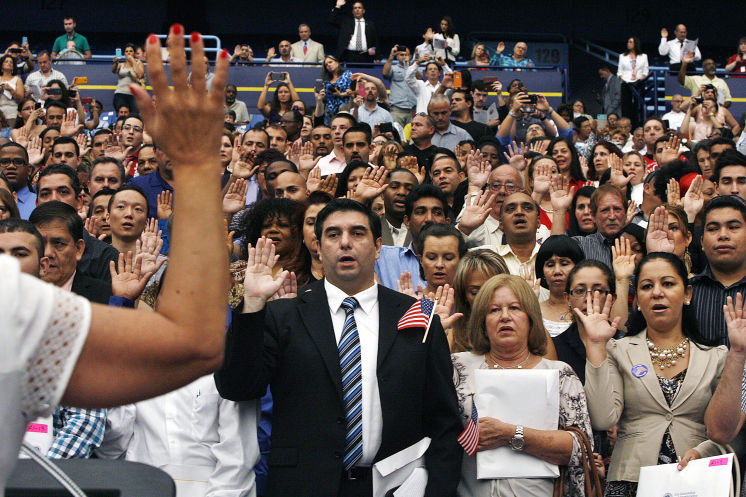 in a setting that hosts america's past time 240 new us citizens take the oath of allegiance at a naturalization oath ceremony before a tampa bay rays detroit tigers baseball game tropicana field thursday august 21 2014 scott keeler times.jpg