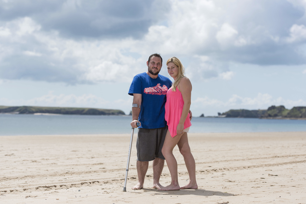 Matthew James and fiancee Saera Wilson of Cardiff pictured at Tenby, Wales. Matthew was shot by the Tunisian gunman while protecting his fiancee. The couple have two children Tegan and Kaden. (Photo by Matthew Horwood/Wales News Service)