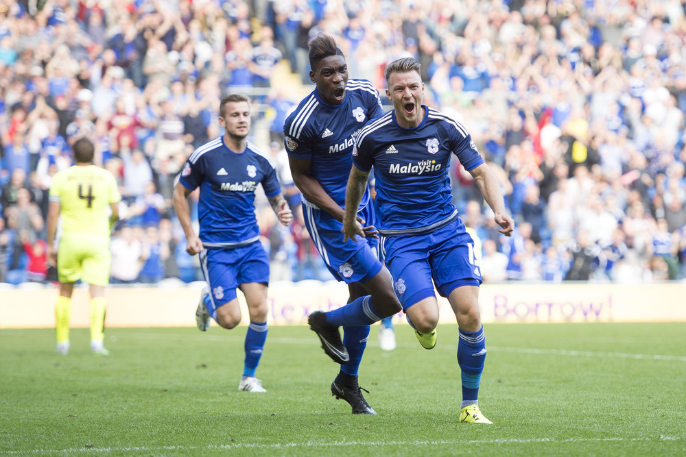 Cardiff City v Huddersfield at the Cardiff City Stadium. Anthony Pilkington (front) celebrates after scoring a goal for Cardiff. (Photo by Matthew Horwood/Wales News Service)