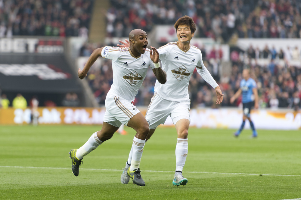 Swansea v Tottenham Hotspur Barclays Premier League match at the Swansea City stadium.  André Ayew (left) celebrates after he scores a goal for Swansea City.