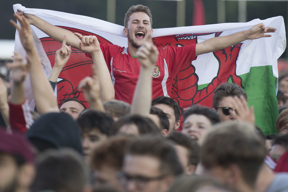Wales fans celebrate a Wales goal at the Wales Fan Zone in Cooper's Field, Cardiff, for the Russia v Wales Euro 2016 Group B game.