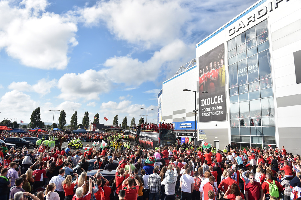CARDIFF, WALES - JULY 08: An open top bus carrying the Wales team arrives at the Cardiff City Stadium on July 8, 2016 in Cardiff, Wales. The players toured the streets of Cardiff in an open top bus before arriving at the Cardiff City Stadium for an after party for which 33,000 tickets have been sold. Wales historic run in Euro 2016 saw them reach the semi-finals, before being knocked out 2-0 by Portugal at Stade de Lyon in France. (Photo by Matthew Horwood/Getty Images)