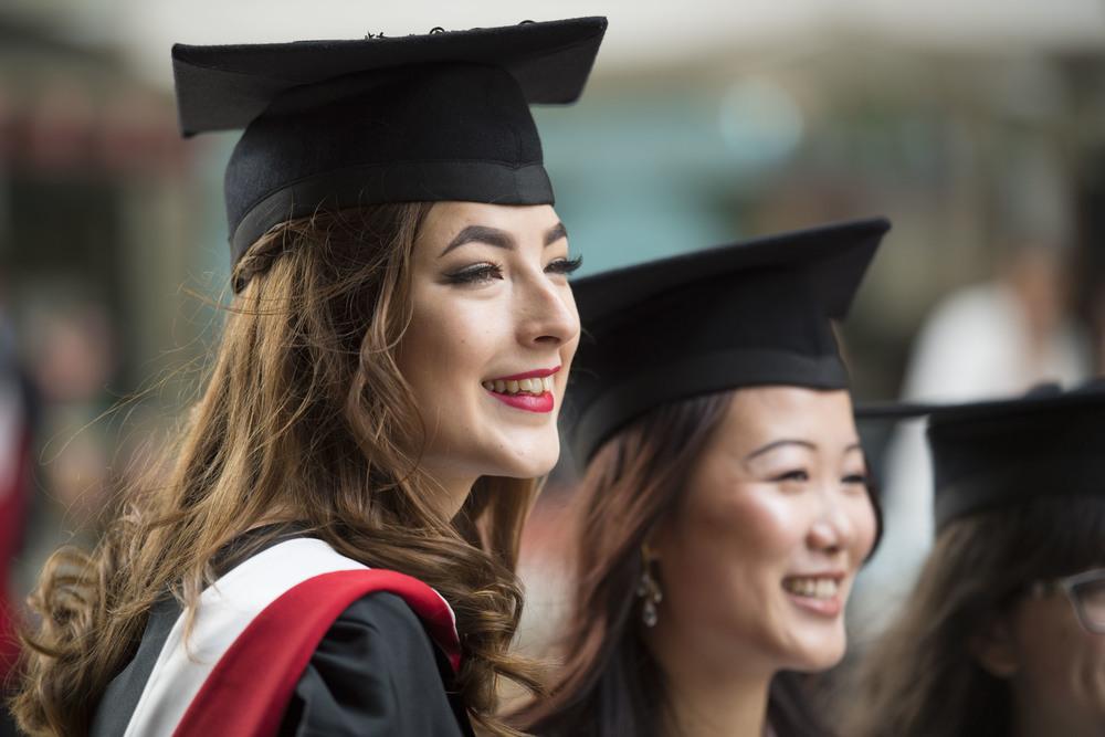 Cardiff University students celebrating graduating from Cardiff University.