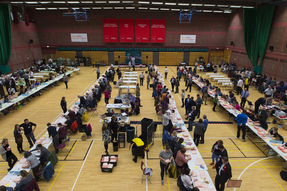 CARDIFF, UNITED KINGDOM - JUNE 09: A general view of counting underway at the Sport Wales National Centre on June 9, 2017 in Cardiff, United Kingdom. After a snap election was called, the United Kingdom went to the polls yesterday following a closely fought election. The results from across the country are being counted and an overall result is expected in the early hours. (Photo by Matthew Horwood/Getty Images)
