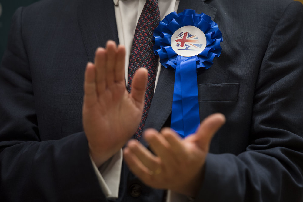 CARDIFF, UNITED KINGDOM - JUNE 09: A Conservative party candidate claps at the Sport Wales National Centre on June 9, 2017 in Cardiff, United Kingdom. After a snap election was called, the United Kingdom went to the polls yesterday following a closely fought election. The results from across the country are being counted and an overall result is expected in the early hours. (Photo by Matthew Horwood/Getty Images)
