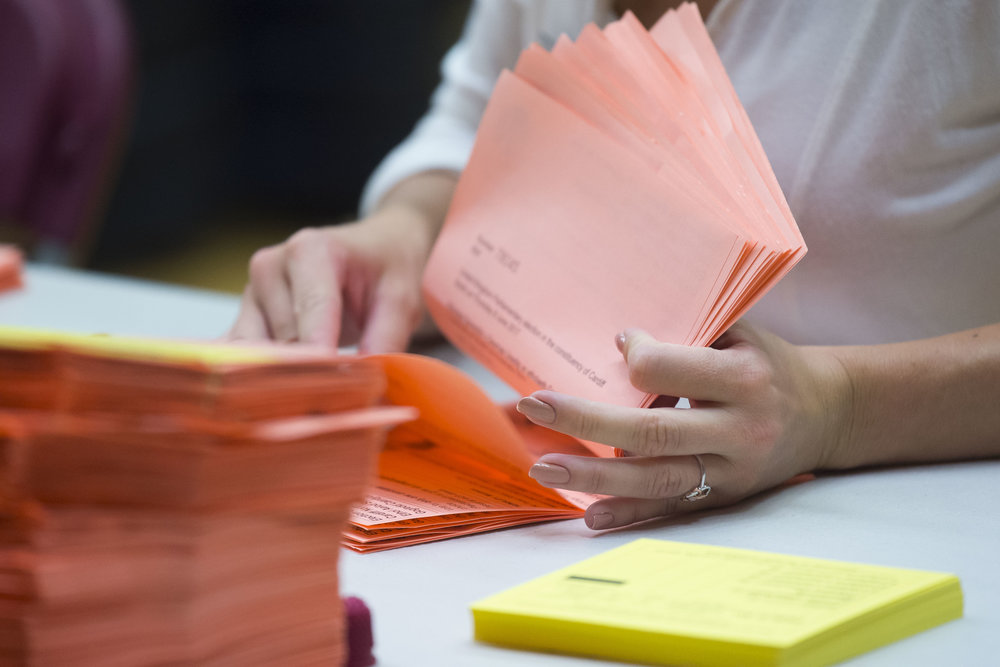 CARDIFF, UNITED KINGDOM - JUNE 09: A closeup view of ballot papers being counted by a woman at the Sport Wales National Centre on June 9, 2017 in Cardiff, United Kingdom. After a snap election was called, the United Kingdom went to the polls yesterday following a closely fought election. The results from across the country are being counted and an overall result is expected in the early hours. (Photo by Matthew Horwood/Getty Images)