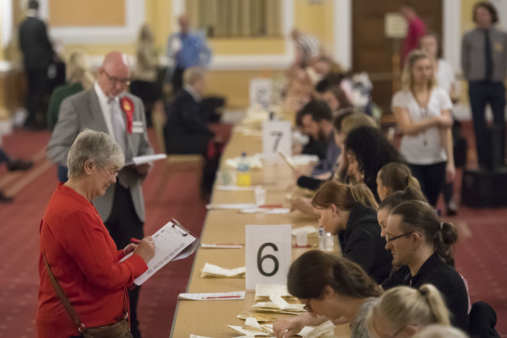 CARDIFF, UNITED KINGDOM - JUNE 08: Votes are counted at City Hall on June 8, 2017 in Cardiff, United Kingdom. After a snap election was called the United Kingdom went to the polls yesterday, a closely fought election the results from across the country are being counted and an overall result is expected in the early hours. (Photo by Matthew Horwood/Getty Images)