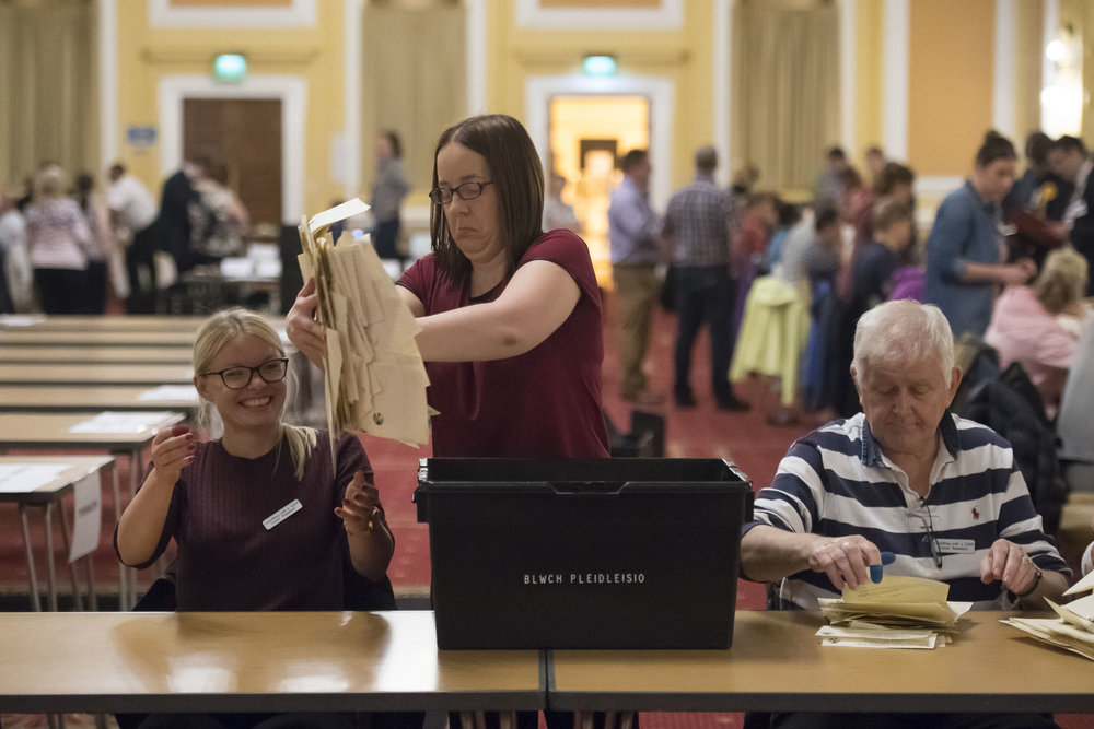 CARDIFF, UNITED KINGDOM - JUNE 09: Ballot papers are removed from ballot boxes to be counted at City Hall on June 9, 2017 in Cardiff, United Kingdom. After a snap election was called the United Kingdom went to the polls today, a closely fought election the results from across the country are being counted and an overall result is expected in the early hours. (Photo by Matthew Horwood/Getty Images)