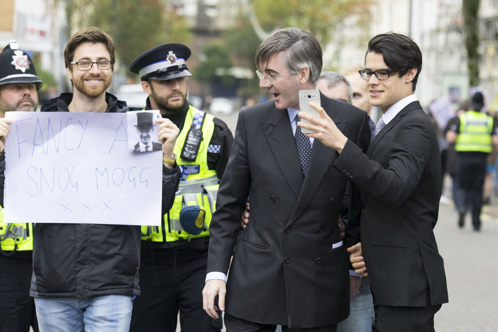 CARDIFF, WALES - SEPTEMBER 29: Jacob Rees-Mogg, MP for North East Somerset, is met by protestors ahead of a talk called Faith in the Future at the Cornerstone Church on September 29, 2017 in Cardiff, Wales. The talk, titled �Faith in the Future�, explores issues surrounding the importance of faith in the public and private life of our society. Jacob Rees-Mogg has recently caused controversy over his opposition to abortion after rape or incest. (Photo by Matthew Horwood/Getty Images)