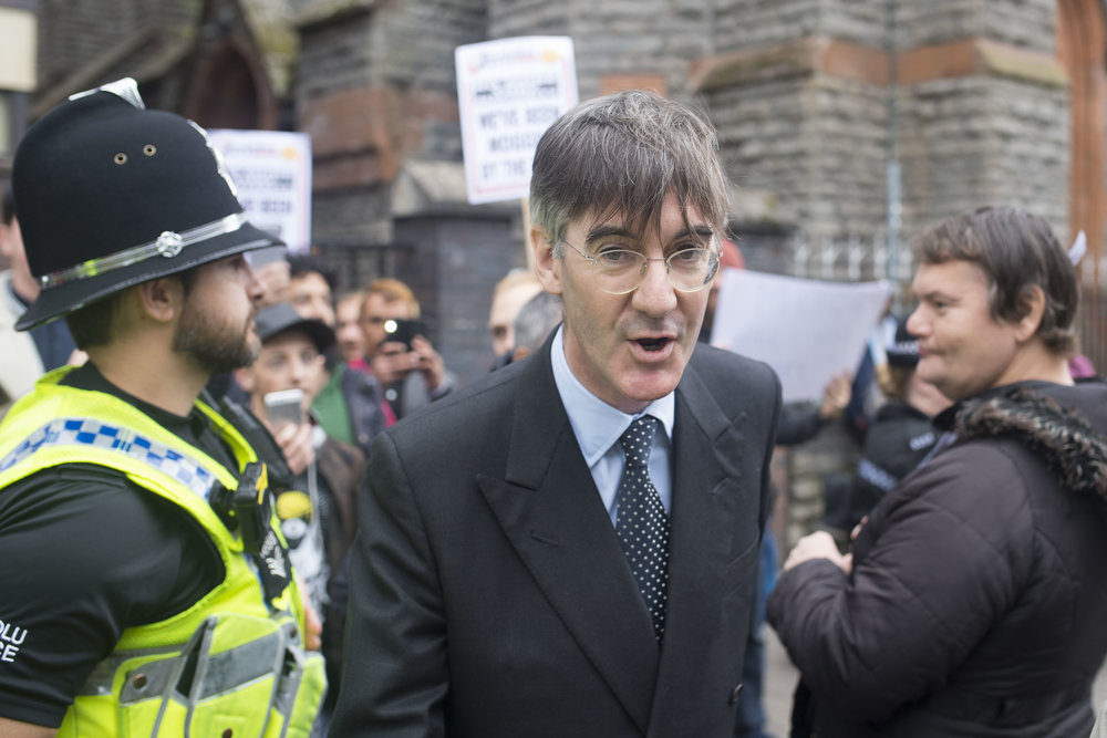 CARDIFF, WALES - SEPTEMBER 29: Jacob Rees-Mogg, MP for North East Somerset is met by protestors ahead of a talk called Faith in the Future at the Cornerstone Church  on September 29, 2017 in Cardiff, Wales. The talk, titled �Faith in the Future�, explores issues surrounding the importance of faith in the public and private life of our society. Jacob Rees-Mogg has recently caused controversy over his opposition to abortion after rape or incest. (Photo by Matthew Horwood/Getty Images)