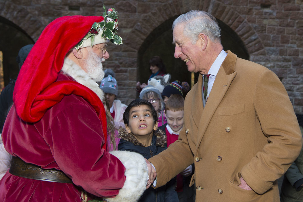 CARDIFF, WALES - DECEMBER 08: The Prince of Wales meets Father Christmas during a visit to Castell Coch to learn about the castle's history, refurbishment and programme of community activities on December 8, 2017 in Cardiff, Wales. (Photo by Matthew Horwood/Getty Images)