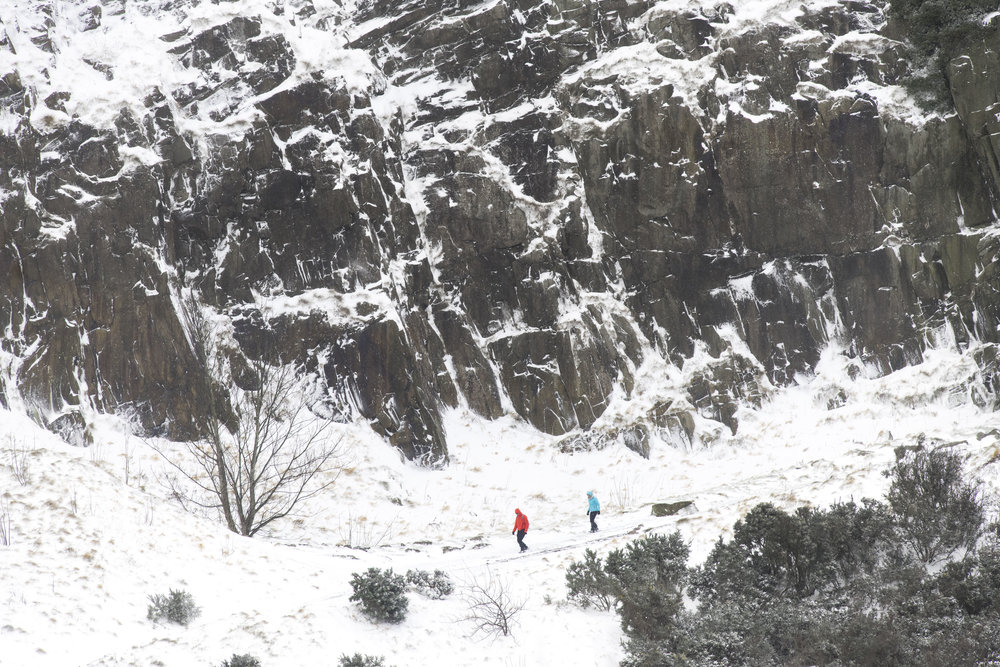 EDINBURGH, SCOTLAND - MARCH 1: Walkers seen in Holyrood Park, home of Arthur's Seat, on March 1, 2018 in Edinburgh, United Kingdom. People have been warned not to make unnecessary journeys as the Met office issues a red weather be aware warning for parts of Wales and South West England following the one currently in place in Scotland. (Photo by Matthew Horwood/Getty Images)