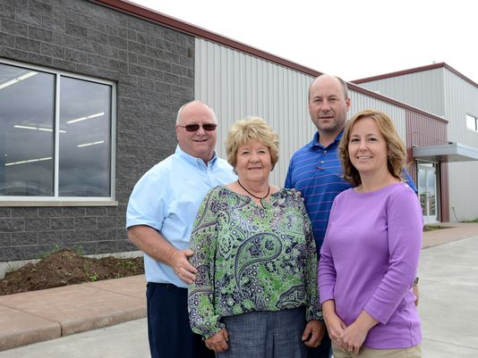 From left, GAT Supply Inc., Tenor Construction Supply & Rental and Survey Supplies & Equipment are driven by George and Karen Tenor, son, Andy, and daughter, Georgina Kaschner, outside their new building at 1020 Glory Road in Ashwaubenon.  (Photo: H. Marc Larson/Press-Gazette Media)    This article was published in the Green Bay Press-Gazette on July 6, 2014.