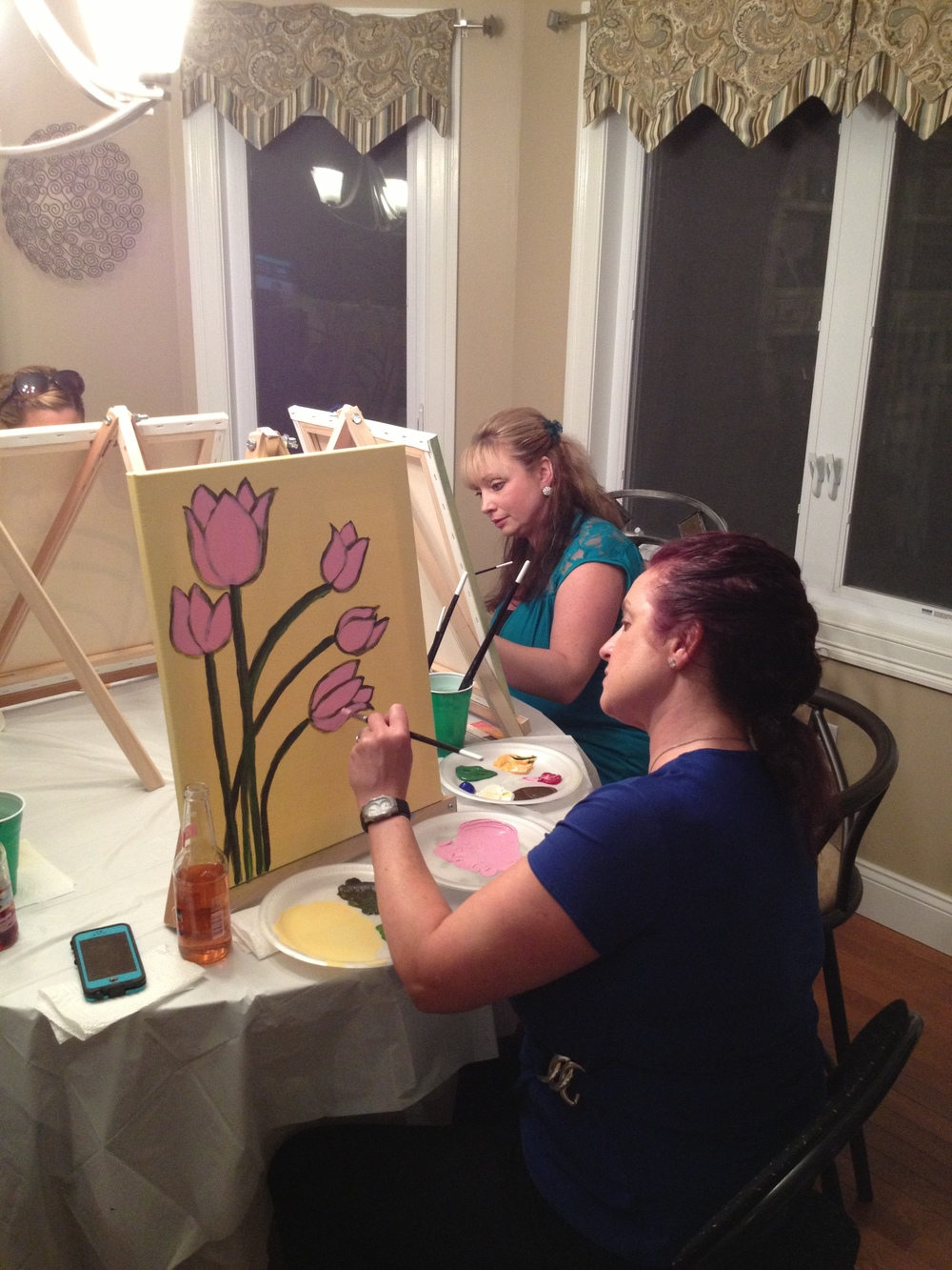 Deb and Kym concentrating Kym's painting was hanging on her wall before everyone left!!
