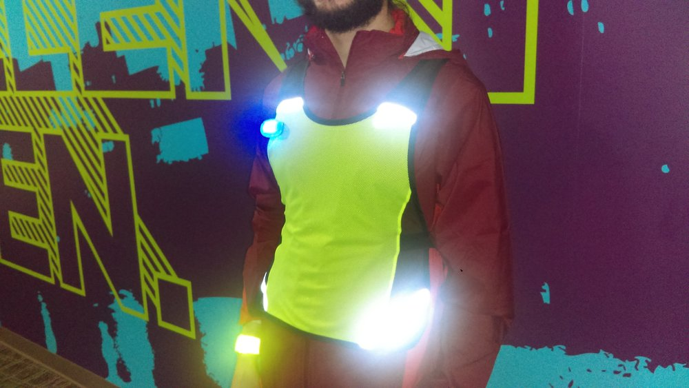 Here, Jason showcases our Brooks reflective running vest with strategically-placed reflective elements for better visibility.