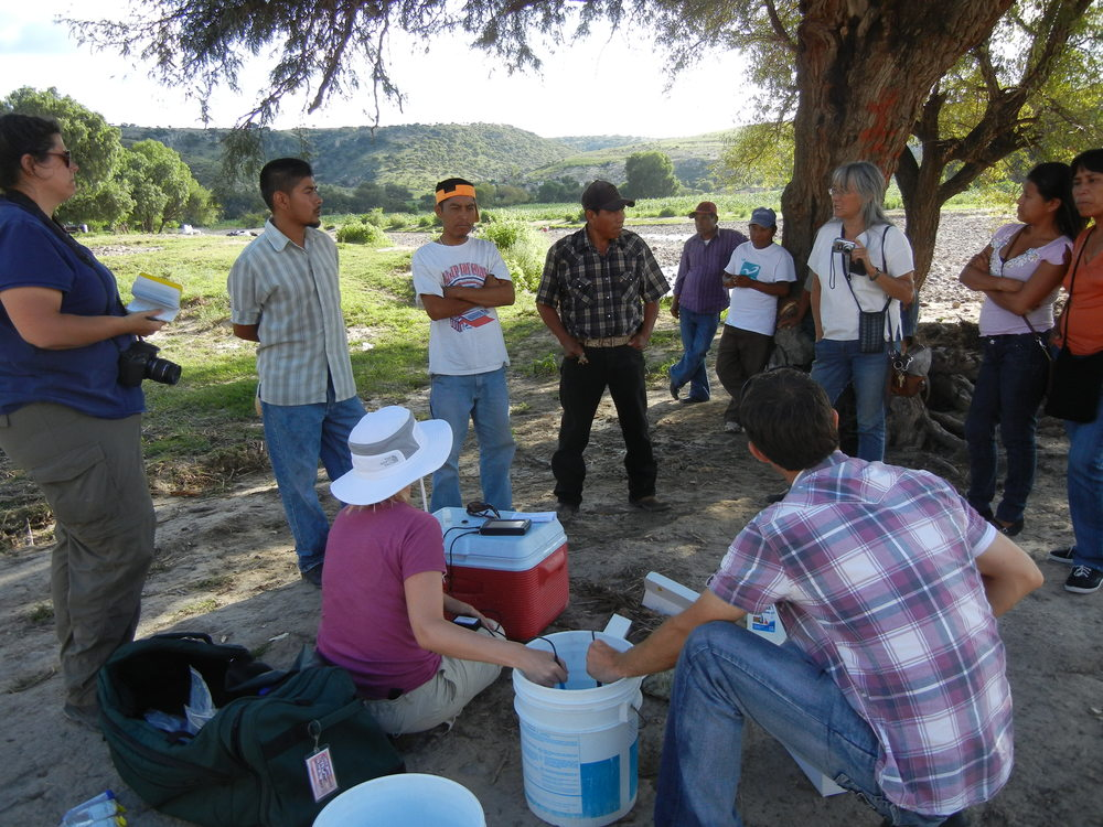 Dr. Lenczewski and students testing the water quality of a local community well in 2011.  Eventually, their work would go on to provide the bulk of the data for our water quality monitoring maps.
