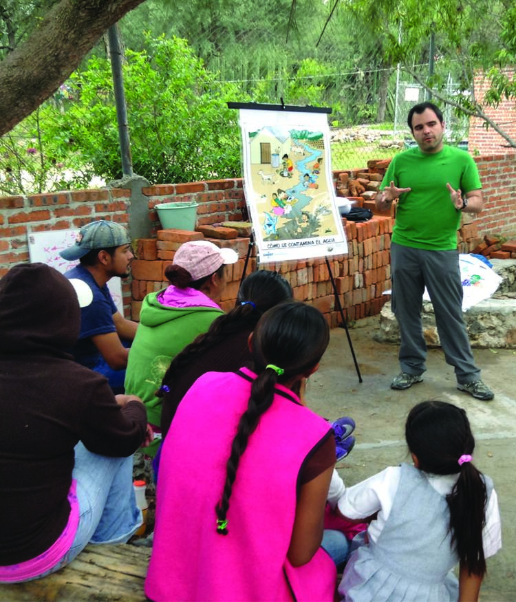 Our first EWB-UK volunteer placement, Javier Sierra, teaching in a local community