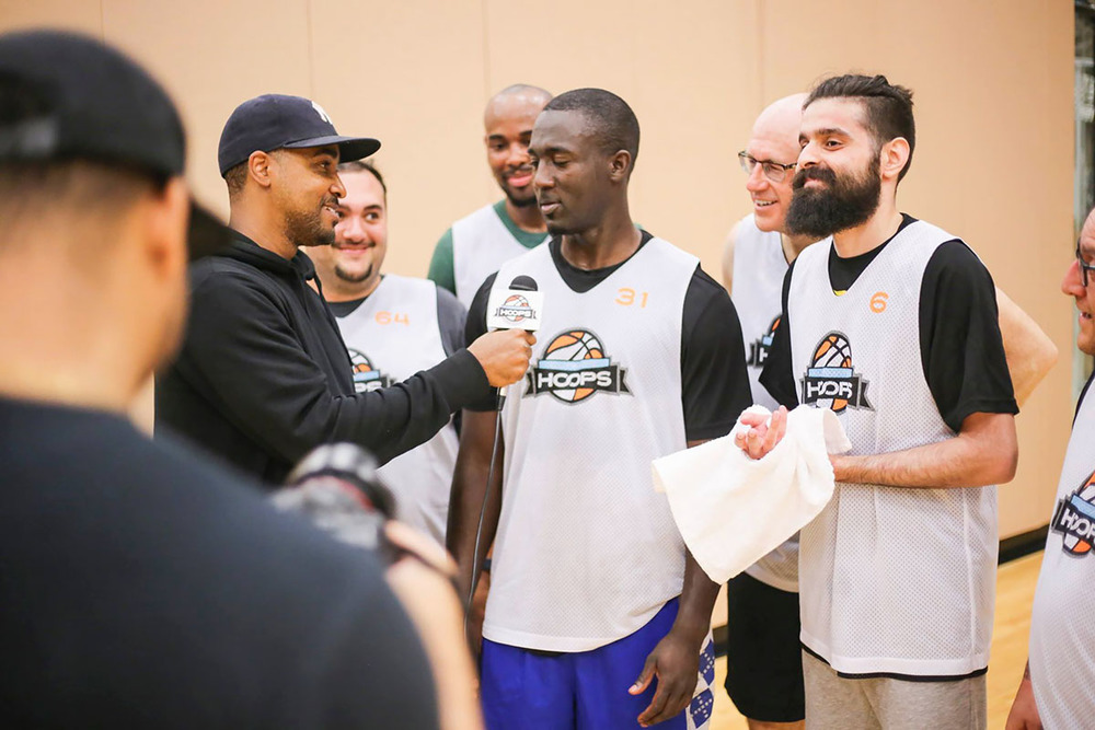 Daniel (left) interviewing league players in Ultimate Hoops Toronto
