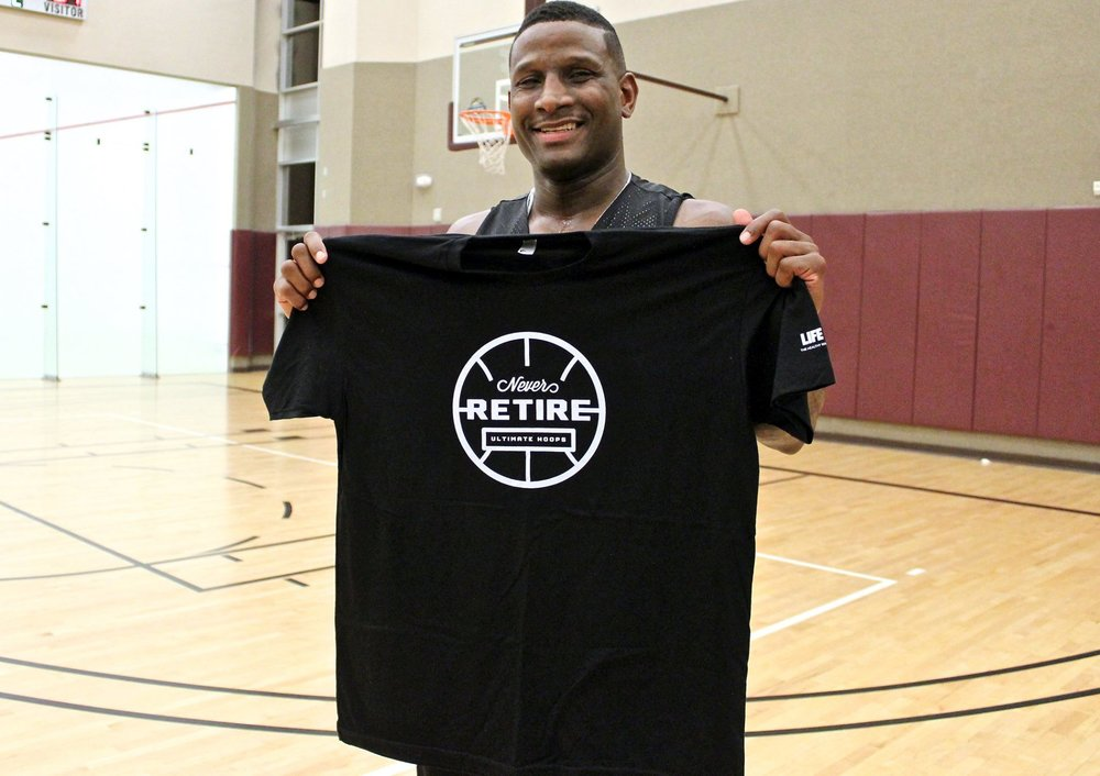 "Tyrone ""TJ"" Jones holding up his MVP T-Shirt. (photo by Donald Dangmuk)"