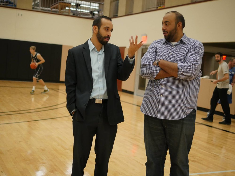 Elkaffas (left) chatting with Helmy when they were both Dream League general managers in 2016.