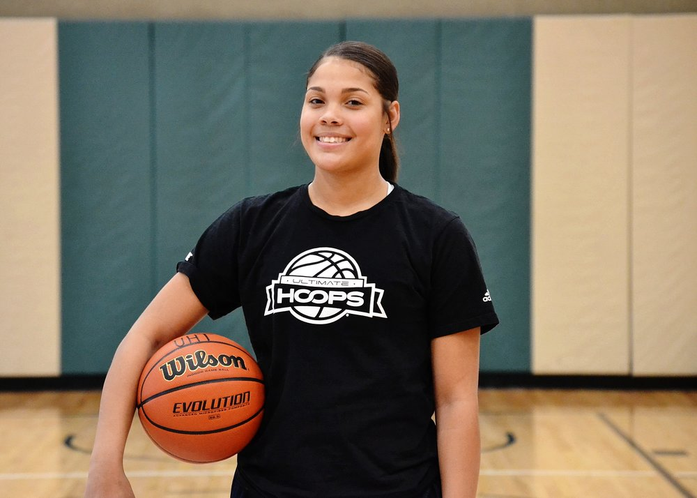 """DeNALI HUGHES - """"I chose Denali because when I first met her I asked her why is she so serious when it comes to basketball and she told me, """"because I take playing seriously."""" Over time I noticed she put so much pressure on herself not to fail that I don't think she knew how to enjoy the game or the process of getting better. Now I think she knows how to enjoy the game and lead by example without having to always physically carry the team by herself. The biggest reason was just because someone isn't looked at as the face of a team or program doesn't mean they don't need to be told how proud you are of them and what they do doesn't go unnoticed.""""-Jazz Williams, Ultimate Hoops Trainer, Colorado Springs"""