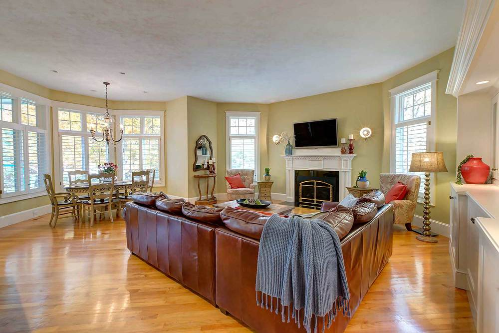 The wall color in the family room is Benjamin Moore Windham Cream. Custom lighting is from Visual Concepts.