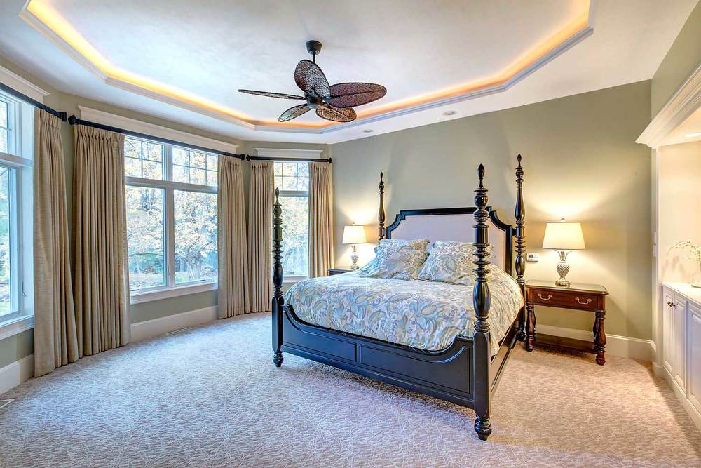 The bedroom furniture is from Hooker Furniture's Estate Line and the draperies are custom.