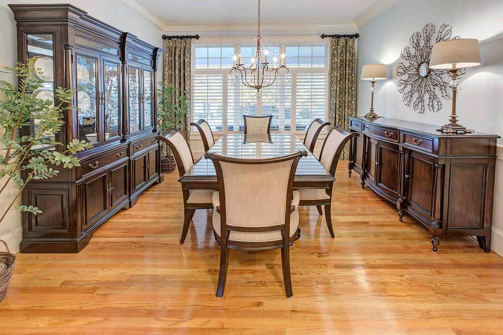The dining room set is from Hooker Furniture. The table has an inlaid star and the china cabinet has seeded glass.