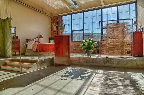 A Bright Spacious Artists Loft With Raised Platform That Delineates The Bedroom From Rest
