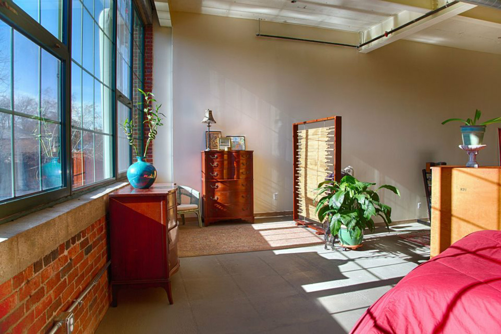 Large windows provide a view of the Western Canal. The furniture was owned by the clients prior to design.