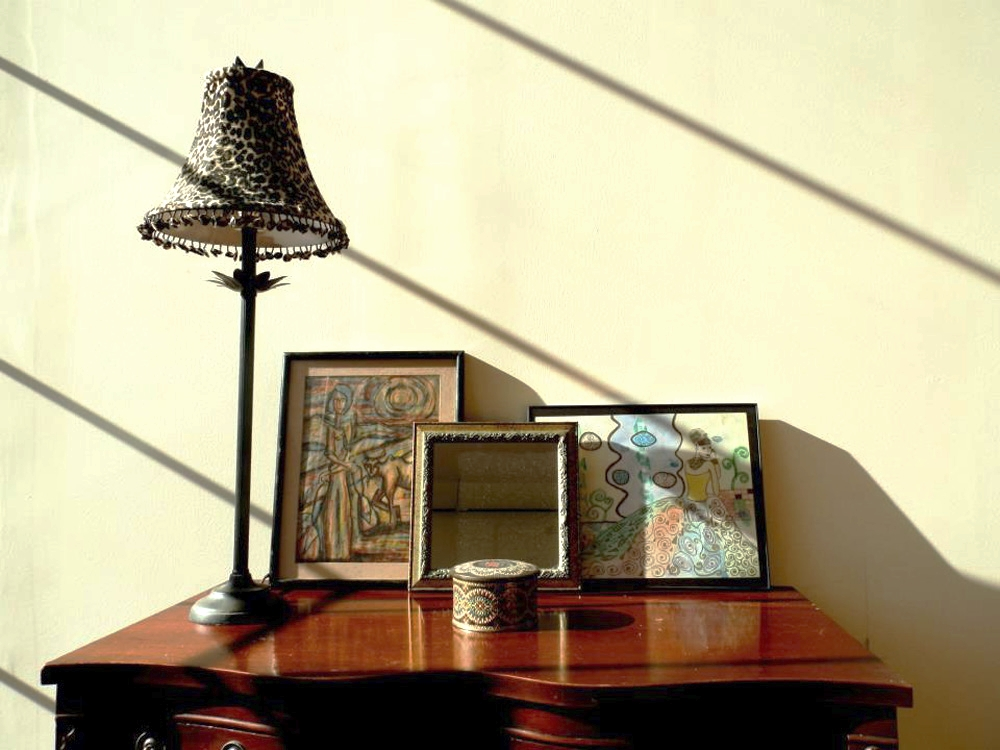 Client provided accessories, artwork and lamps bring an eclectic feel to this bright open loft.