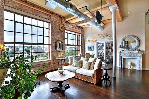 Open concept loft living with exposed brick and historical design elements.