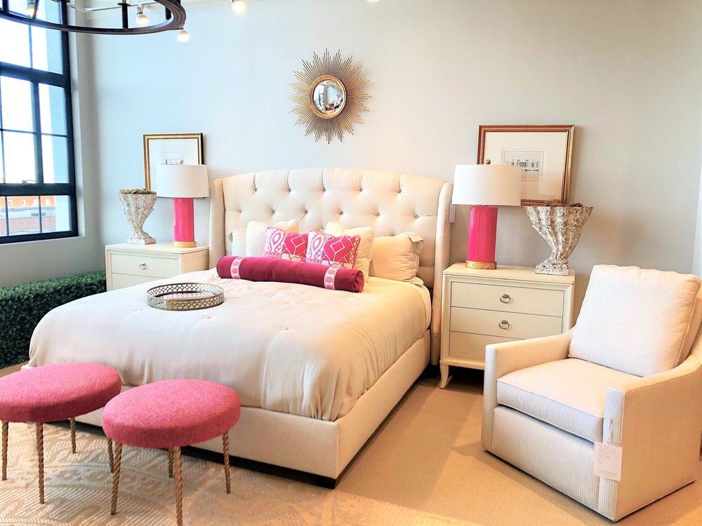 White bedroom again warm gray wall with fuchsia accent pillows, lamps, and footstools, metal mirror and frames (2).JPG