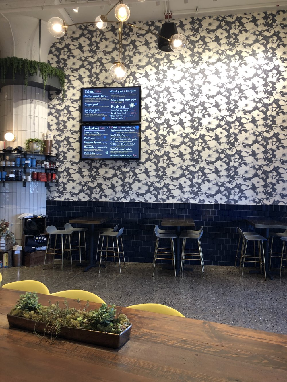 Flour Restaurant in Boston - Bold floral wallpaper with navy tiles.jpg