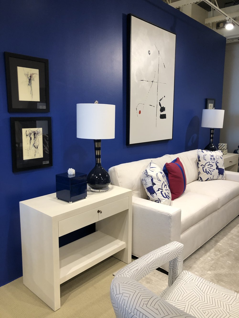Bold colorful wall with white furniture at Century Furniture.jpg