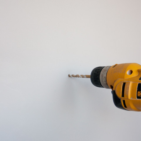 1) Drill a hole into the drywall -Make sure to drill the hole perpendicular to the wall -Choose a drill bit that is a little smaller than the closed end of the plastic anchor