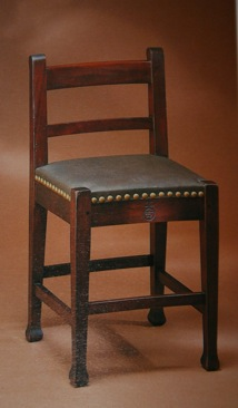 The Roycroft Shop, Marshall P. Wilder chair, 1906-1912 Mahogany, oak (replaced), leather, brass, 35 1/16 x 17 x 17 ¼ in Los Angeles County Museum of Art