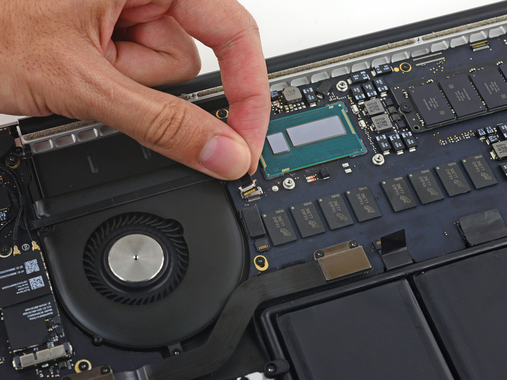 Photo 3. A focused, crisp image with an uncluttered background clearly shows how this technician detaches a delicate cable inside a 2014 MacBook Pro.