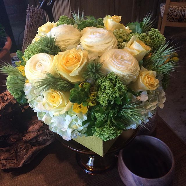 """we're having an early dinner tonight at Craft.  Can you make us something pretty for our table?"". Here you go!  #sticksandstones #craftlosangeles #beverlyhills #yellowroses #viburnum #ranunculus"