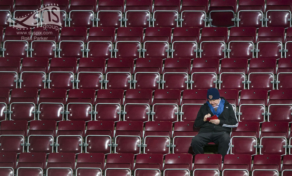 A very punctual Hearts fan takes his seat at Tynecastle before his sides league encounter with Dundee United.
