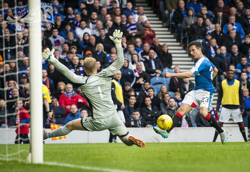 Jason Holt of Rangers scores his sides equaliser against Queen of the South at Ibrox Stadium.