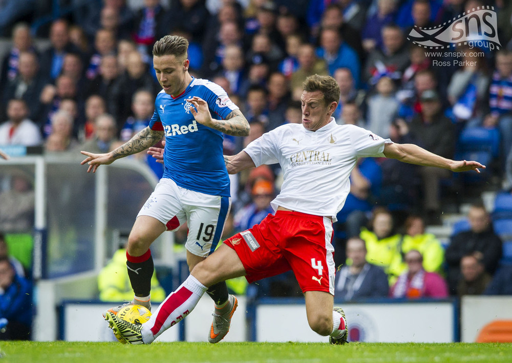 Rangers Barry McKay tries to evade the challenge of Falkirk's aaron Muirhead.