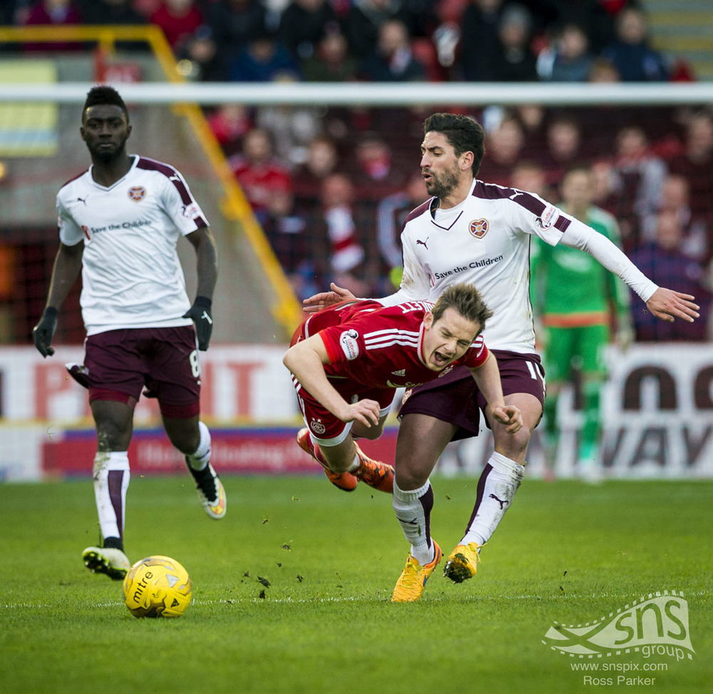 Miguel Pallardo of Hearts wipes out Aberdeen's Peter Pawlett at Pittodrie.