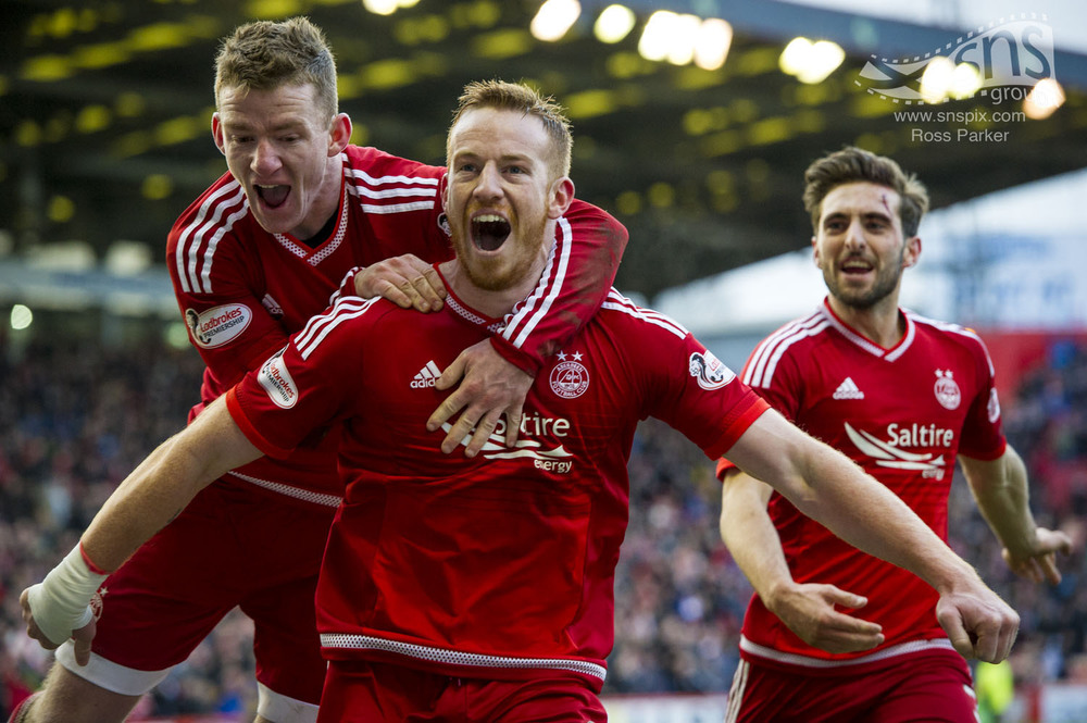 Adam Rooney celebrates scoring a late winner for Aberdeen with team mates Jonny Hayes and Graeme Shinnie.