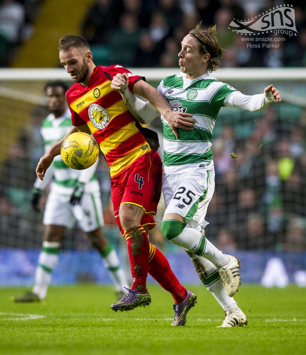 Sean Welsh of Partick Thistle holds off Celtic's Stefan Johansen