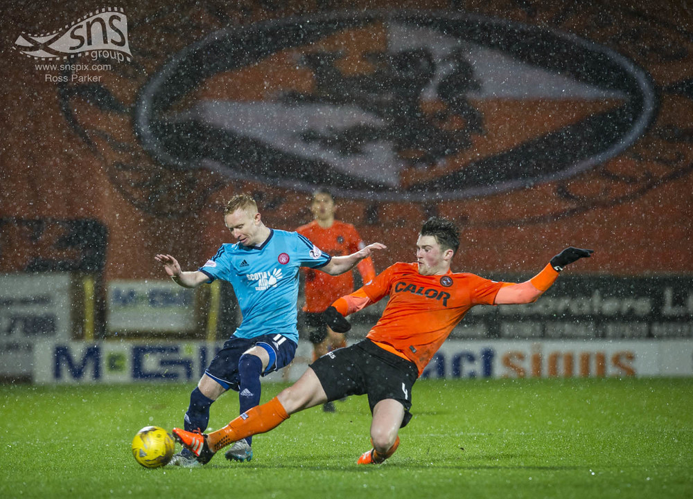 Hamilton's Ali Crawford and John Souttar of Dundee United battle for possession in a rain soaked match at Tannadice.