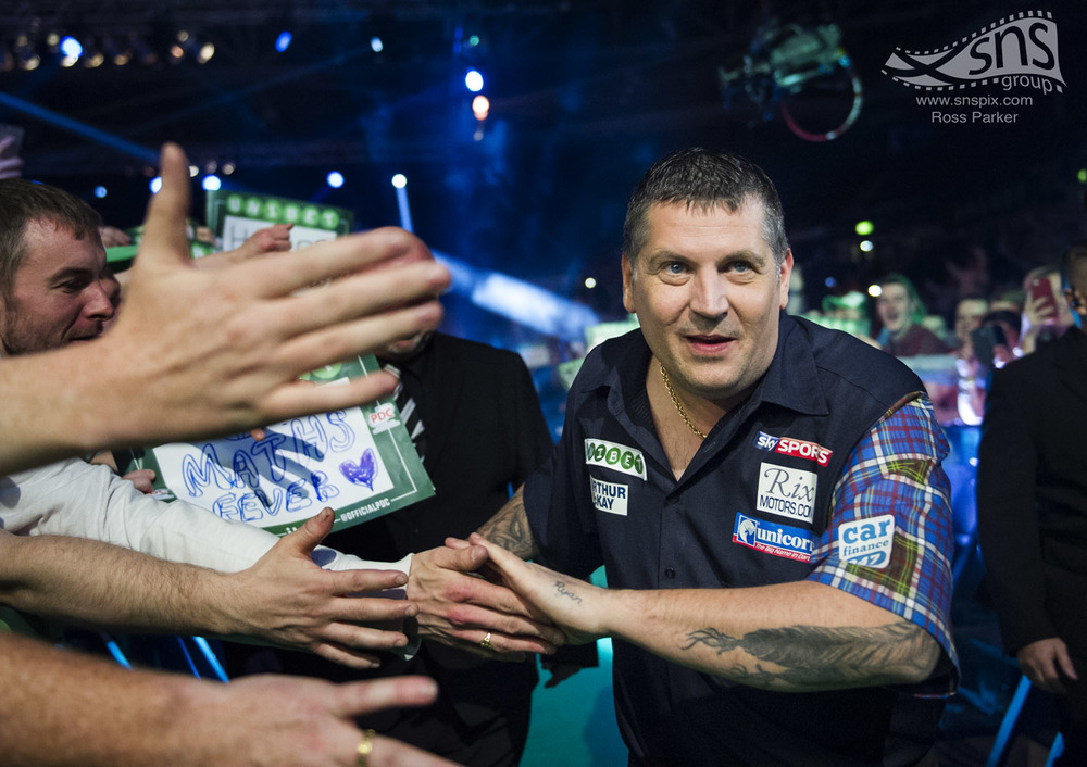 Gary Anderson makes his way to the stage during the World Series of Darts at the Braehead Arena in Glasgow.