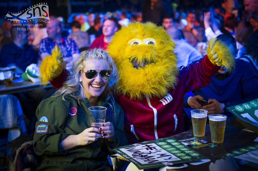 Darts fans in fancy dress enjoy a few drinks at the World Series of Darts in Glasgow.