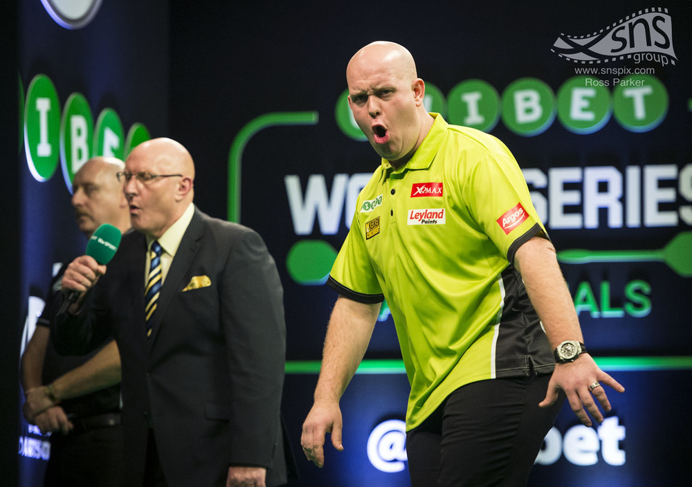 Michael Van Gerwin celebrates scoring 180 during the World Series of Darts in Glasgow.